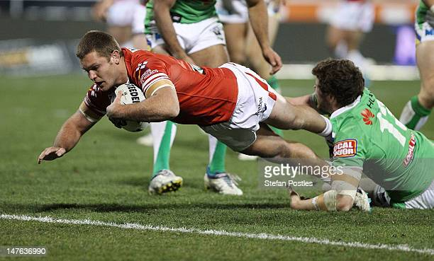 Mitch Rein of the Dragons scores a try during the round 17 NRL match between the Canberra Raiders and the St George Dragons at Canberra Stadium on...