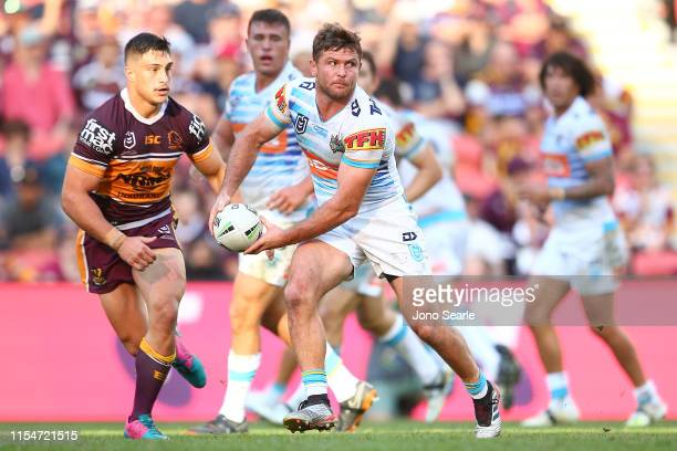 Mitch Rein of the Titans passes the ball during the round 13 NRL match between the Brisbane Broncos and the Gold Coast Titans at Suncorp Stadium on...