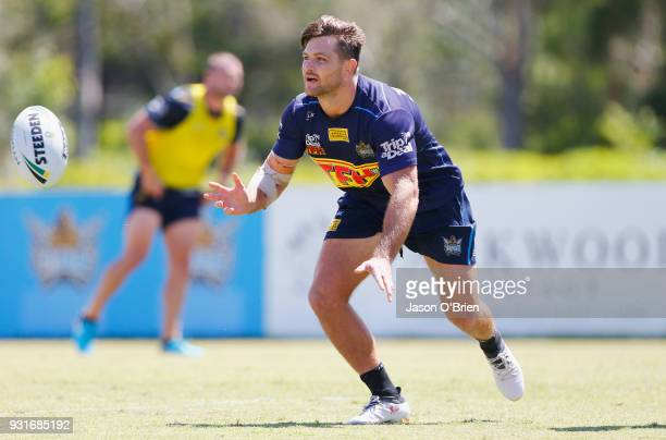 Mitch Rein passes the ball during a Gold Coast Titans NRL training session at Parkwood on March 14 2018 in Gold Coast Australia