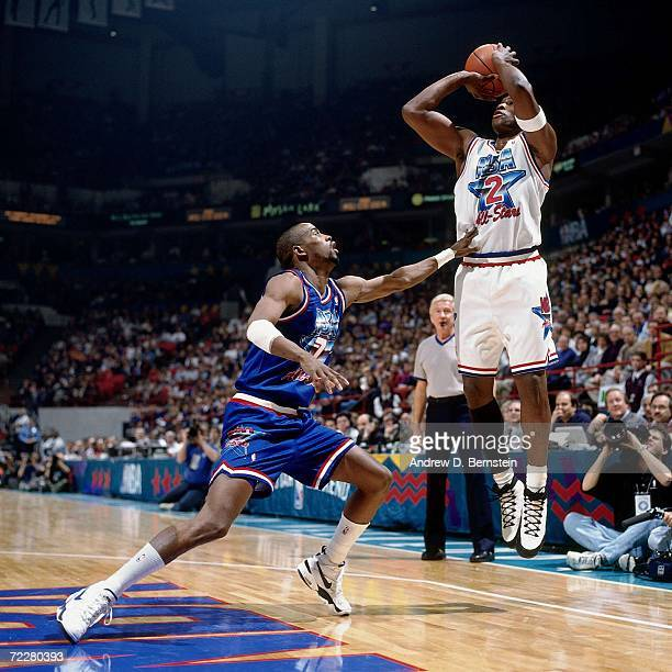 Mitch Richmond of the Western Conference All Stars shoots against Kenny Anderson of the Eastern Conference All Stars during the 1994 NBA All Star...