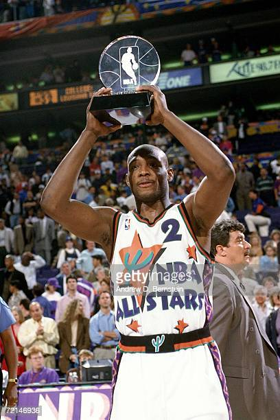Mitch Richmond of the Western Conference AllStars displays his MVP trophy after the 1995 NBA AllStar Game played February 12 1995 at America West...