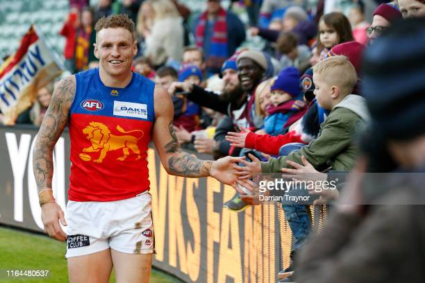 Mitch Robinson of the Lions acknowledges the fans after the round 19 AFL match between the Hawthorn Hawks and the Brisbane Lions at University of...