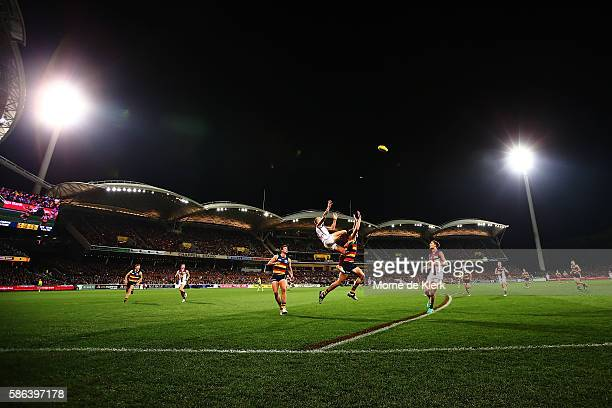 Mitch Robinson of the Lions attempts a mark during the round 20 AFL match between the Adelaide Crows and the Brisbane Lions at Adelaide Oval on...
