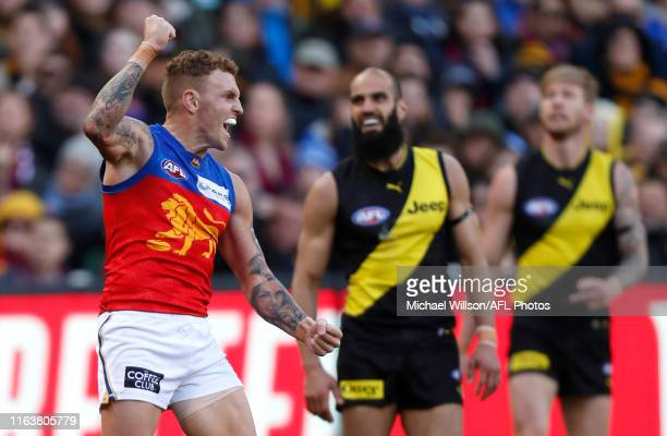 Mitch Robinson of the Lions celebrates a goal during the 2019 AFL round 23 match between the Richmond Tigers and the Brisbane Lions at the Melbourne...