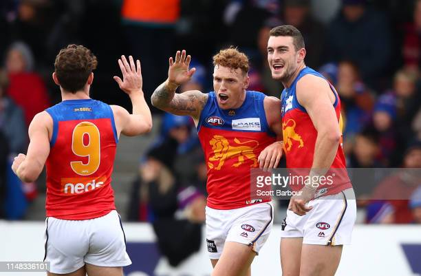 Mitch Robinson of the Lions celebrates after kicking a goal during the round eight AFL match between the Western Bulldogs and the Brisbane Lions at...