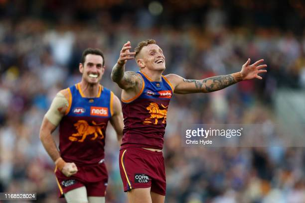Mitch Robinson of the Lions celebrates winning the round 22 AFL match between the Brisbane Lions and the Geelong Cats at The Gabba on August 17 2019...