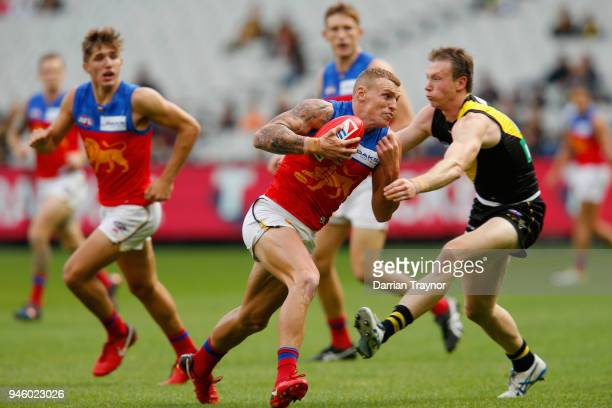 Mitch Robinson of the Lions evades a tackle during the round four AFL match between the Richmond Tigers and the Brisbane Lions at Melbourne Cricket...