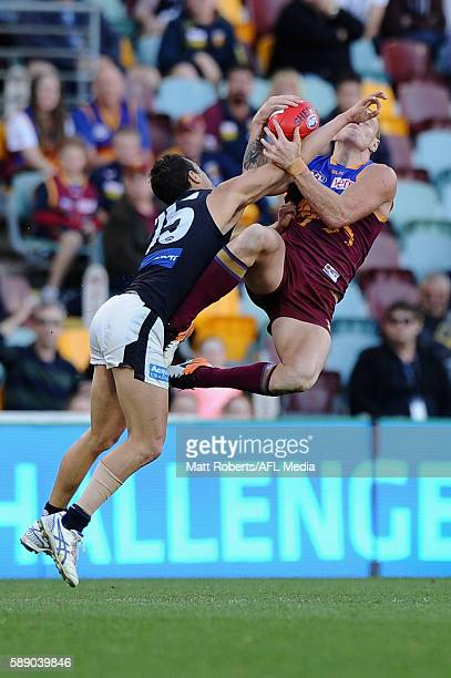 Mitch Robinson of the Lions marks under pressure during the round 21 AFL match between the Brisbane Lions and the Carlton Blues at The Gabba on...