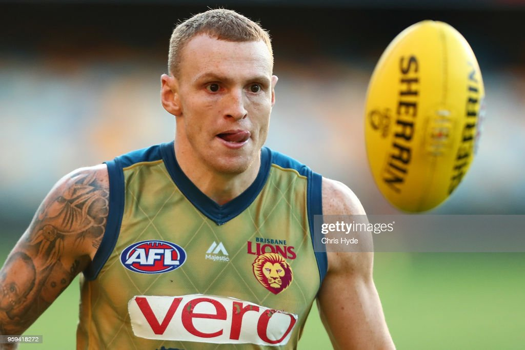 Mitch Robinson runs for the ball during the Brisbane Lions AFL training session at The Gabba on May 17, 2018 in Brisbane, Australia.