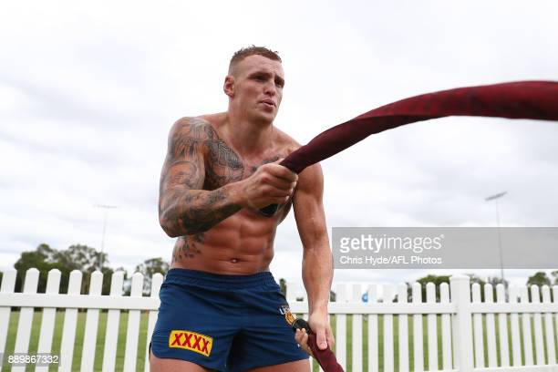 Mitch Robinson trains on the battle ropes during the Brisbane Lions AFL preseason training session at Yeronga on December 11 2017 in Brisbane...