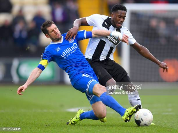 Mitch Rose of Notts County is challenged by Danny Hollands of Eastleigh during the Vanarama National League match between Notts County and Eastleigh...