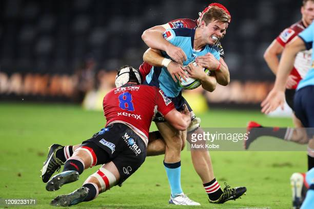 Mitch Short of the Waratahs is tackled during the round five Super Rugby match between the Waratahs and the Lions at Bankwest Stadium on February 28,...