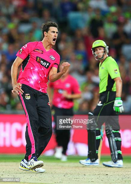 Mitch Starc of the Sixers celebrates after claiming the wicket of Jacques Kallis of the Thunder during the Big Bash League match between the Sydney...