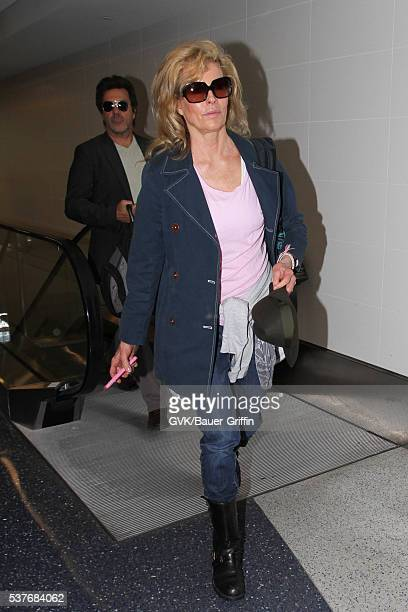 Mitch Stone and Kim Basinger are seen at LAX on June 02 2016 in Los Angeles California