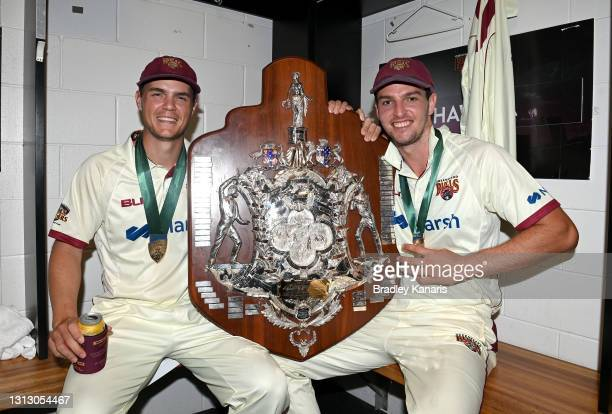 Mitch Swepson and Jack Wildermuth of Queensland celebrate victory during day four of the Sheffield Shield Final match between Queensland and New...