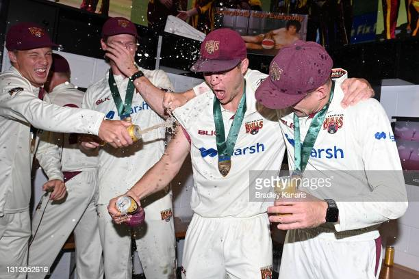 Mitch Swepson and Marnus Labuschagne of Queensland celebrate victory during day four of the Sheffield Shield Final match between Queensland and New...