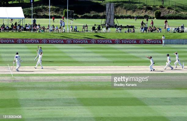 Mitch Swepson of Queensland celebrates after taking the wicket of Baxter Holt of New South Wales during day four of the Sheffield Shield Final match...