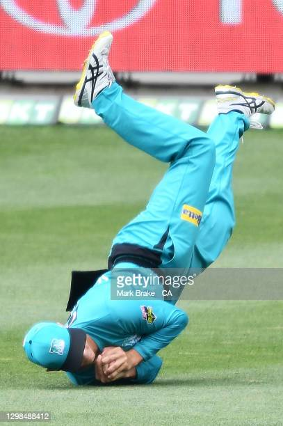 Mitch Swepson of the Heat catches Colin Munro of the Scorchers during the Big Bash League match between the Brisbane Heat and Perth Scorchers at...