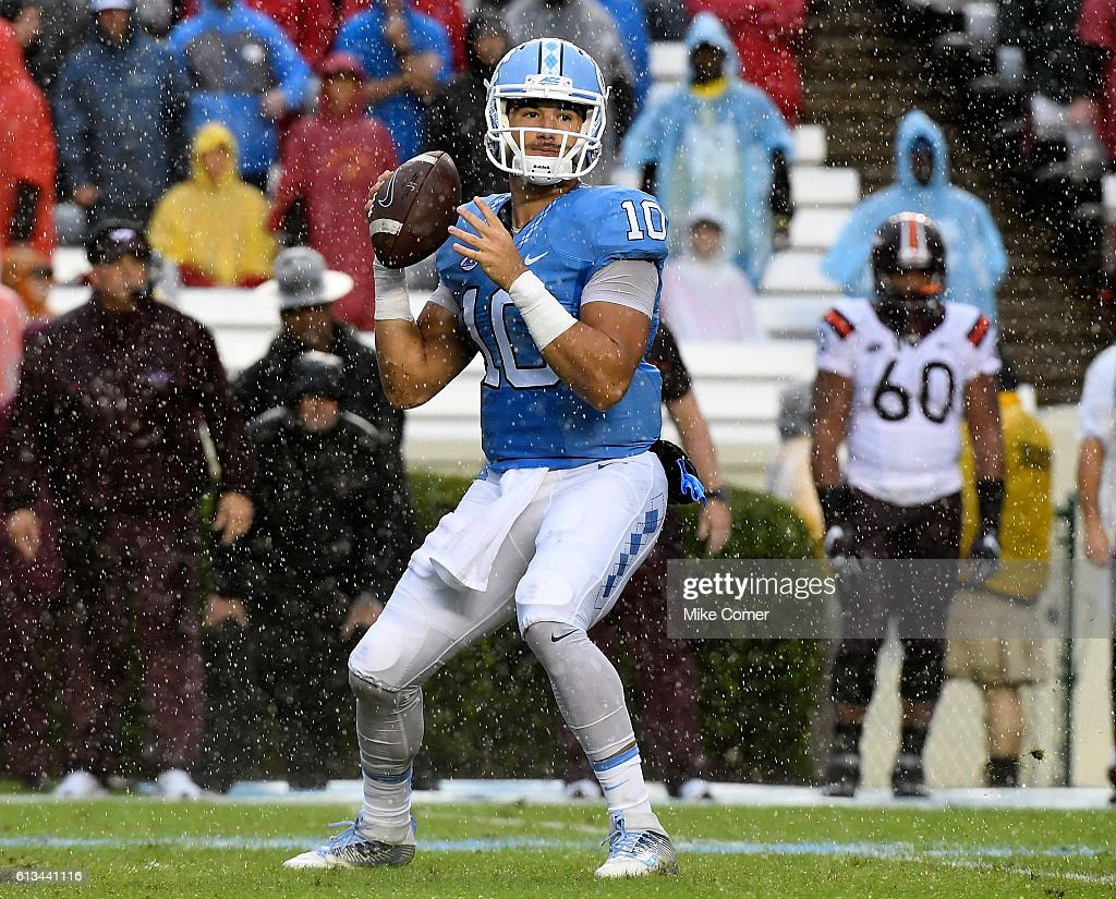 Mitch Trubisky #10 of the UNC Tar Heels drops back to pass against the Virginia Tech Hokies at Kenan Stadium on October 8, 2016 in Chapel Hill, North Carolina.