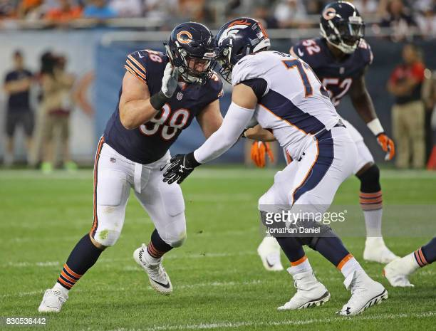 Mitch Unrein of the Chicago Bears rushes against Garett Bolles of the Denver Broncos during a preseason game at Soldier Field on August 10 2017 in...