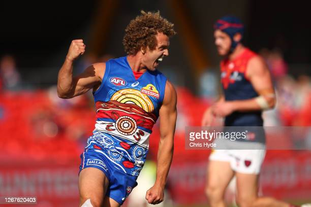 Mitch Wallis of the Bulldogs celebrates a goal during the round 13 AFL match between the Western Bulldogs and the Melbourne Demons at Metricon...