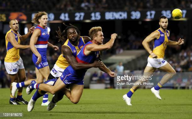 Mitch Wallis of the Bulldogs is tackled by Nic Naitanui of the Eagles during the 2021 AFL Round 02 match between the Western Bulldogs and the West...