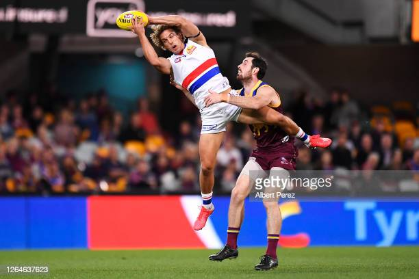 Mitch Wallis of the Bulldogs takes a mark during the round 11 AFL match between the Brisbane Lions and the Western Bulldogs at The Gabba on August...
