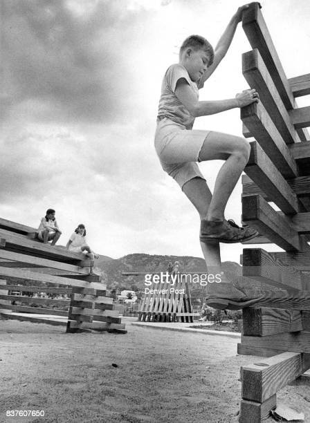 Mitch Willis Of Boulder Scrambles Up Unusual Structure In Park City and Chamber of Commerce officials dedicated H Paul Crouch Memorial Playground in...