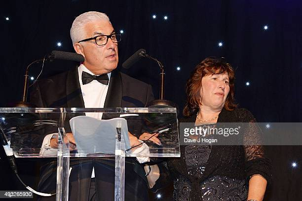 Mitch Winehouse and Janis Seaton speak during the Amy Winehouse Foundation Gala at The Savoy Hotel on October 15 2015 in London England