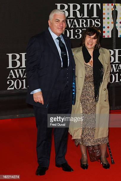 Mitch Winehouse and Janis Winehouse attend the Brit Awards at 02 Arena on February 20 2013 in London England