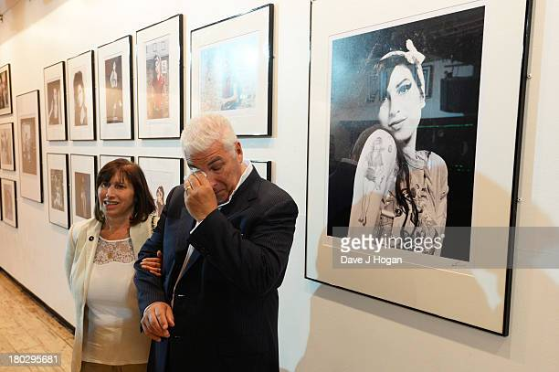 Mitch Winehouse and Janis Winehouse attend the opening of The Amy Winehouse Foundation exhibition to mark her 30th birthday at The Proud Gallery on...