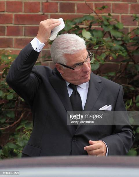 Mitch Winehouse attends a service for the cremation of his daughter Amy Winehouse at Golders Green Crematorium on July 26 2011 in London England