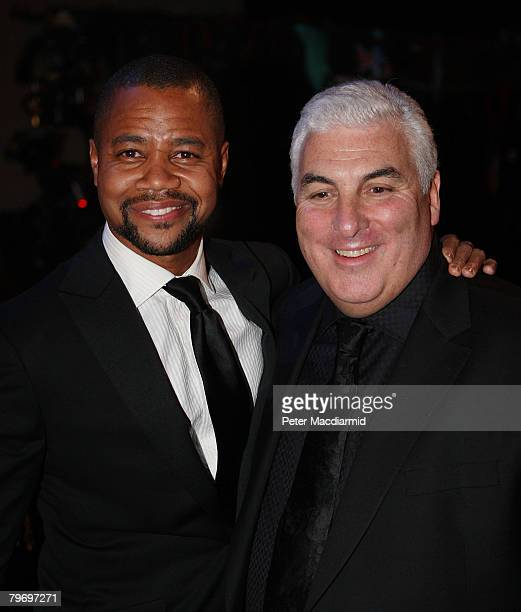 Mitch Winehouse father of Amy Winehouse stands with actor Cuba Gooding Jr at the Riverside Studios for the 50th Grammy Awards ceremony via video link...