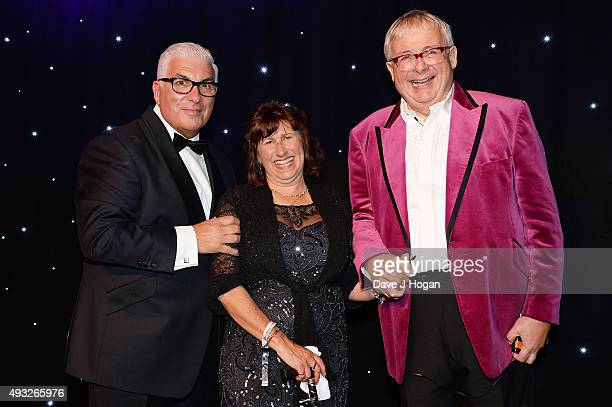 Mitch Winehouse Janis Seaton and Christopher Biggins attend the Amy Winehouse Foundation Gala at The Savoy Hotel on October 15 2015 in London England