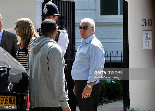 Mitch Winehouse walsk to Amy's house to look at floral tributes at Amy's house by fans on July 25 2011 in London England