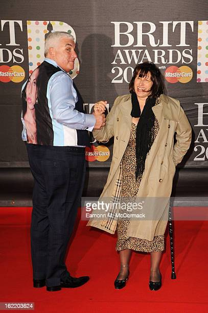 Mitch Winehouse wears a tribute to late daughter Amy Winehouse with mother Janis Winehouse at the Brit Awards 2013 at the 02 Arena on February 20...