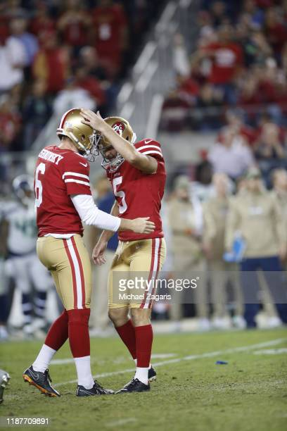 Mitch Wishnowsky and Chase McLaughlin of the San Francisco 49ers celebrates after McLaughlin made a field goal during the game against the Seattle...