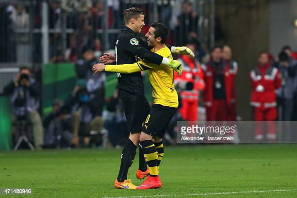 Mitchel Langerak keeper of Dortmund celebrates with his team mate Henrikh Mkhitaryan after the penalty shot out for the DFB Cup Semi Final match...