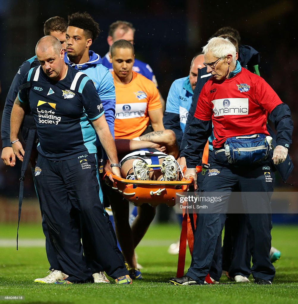 Mitchell Achurch of Leeds Rhinos is carried off the field on a stretcher during the Round 2 match of the First Utility Super League Super 8s between Leeds Rhinos and Wigan Warriors at Headingley Carnegie Stadium on August 14, 2015 in Leeds, England.