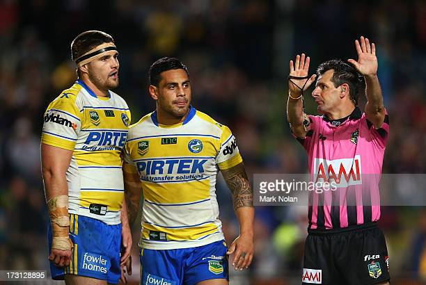 Mitchell Allgood of the Eels is sent to the sin bin by referee Gavin Badger after punching Steve Matai of Manly as Eels captain Reni Maitua watches...