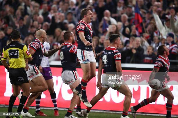 Mitchell Aubusson of the Roosters and team mates celebrate victory at the end of the 2018 NRL Grand Final match between the Melbourne Storm and the...