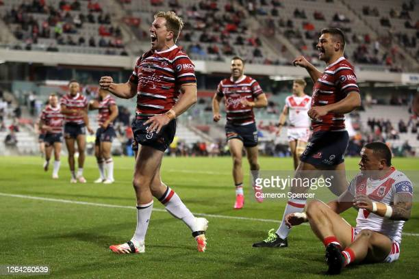 Mitchell Aubusson of the Roosters celebrates after scoring a try during the round 13 NRL match between the St George Illawarra Dragons and the Sydney...