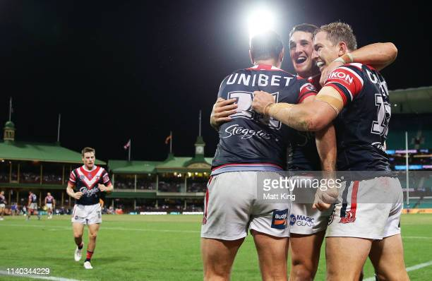 Mitchell Aubusson of the Roosters celebrates with team mates after scoring a try during the round four NRL match between the Sydney Roosters and the...