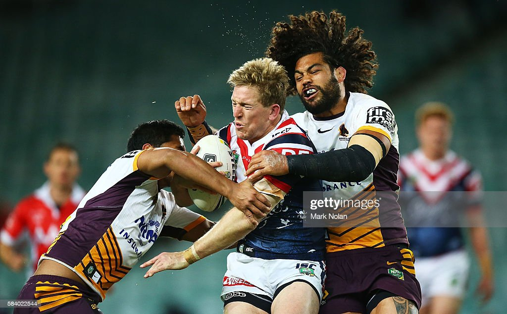 Mitchell Aubusson of the Roosters is tackled by Adam Blair of the Broncos during the round 21 NRL match between the Sydney Roosters and the Brisbane Broncos at Allianz Stadium on July 28, 2016 in Sydney, Australia.