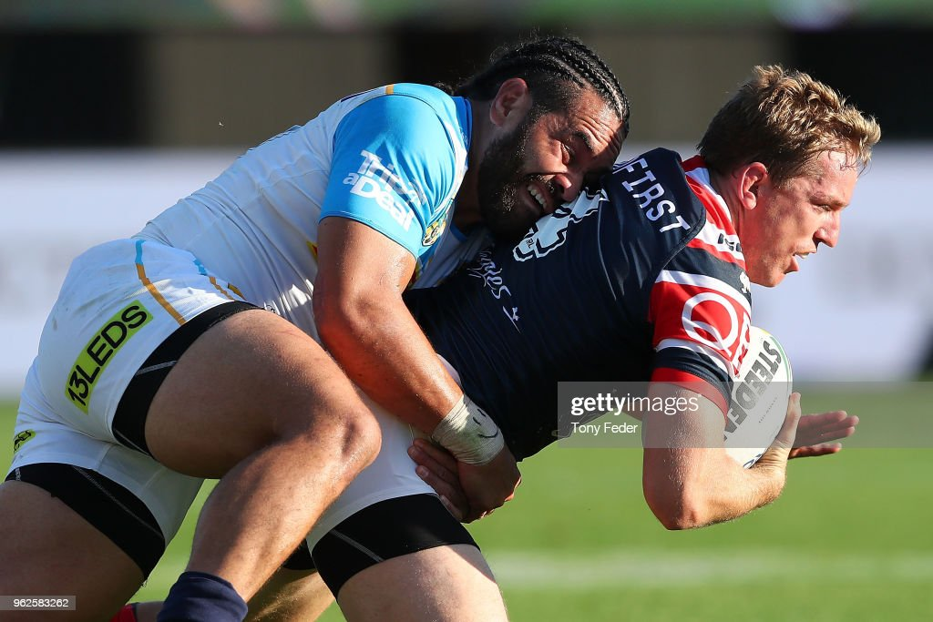 Mitchell Aubusson of the Roosters is tackled by Konrad Hurrell of the Titans during the round 12 NRL match between the Sydney Roosters and the Gold Coast Titans at Central Coast Stadium on May 26, 2018 in Gosford, Australia.