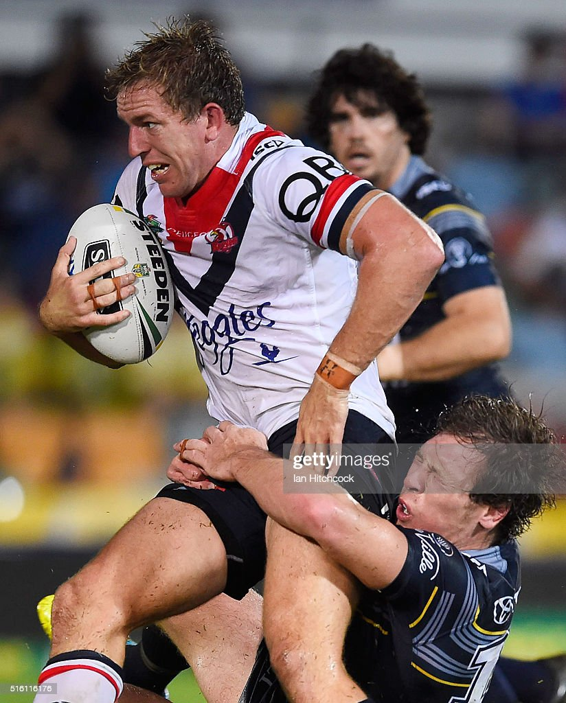 Mitchell Aubusson of the Roosters is tackled by Rory Kostjasyn of the Cowboys during the round three NRL match between the North Queensland Cowboys and the Sydney Roosters at 1300SMILES Stadium on March 17, 2016 in Townsville, Australia.
