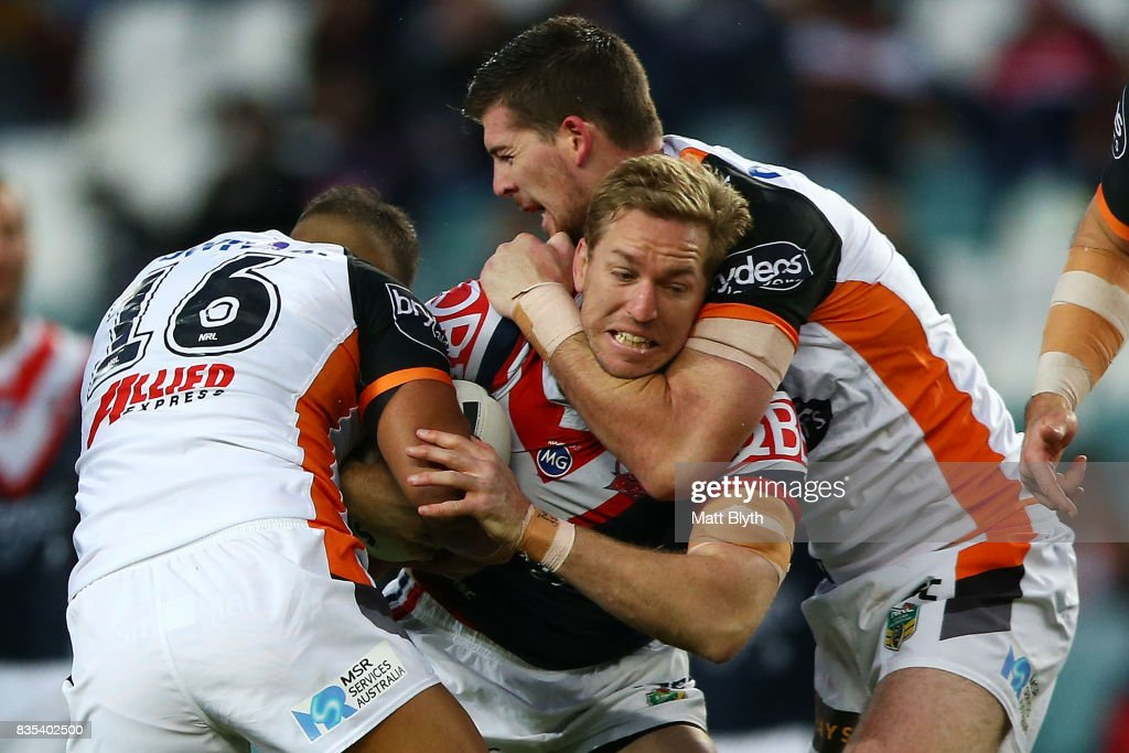 Mitchell Aubusson of the Roosters is tackled during the round 24 NRL match between the Sydney Roosters and the Wests Tigers at Allianz Stadium on August 19, 2017 in Sydney, Australia.