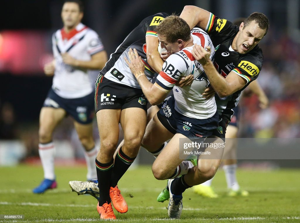 Mitchell Aubusson of the Roosters is tackled during the round three NRL match between the Penrith Panthers and the Sydney Roosters at Pepper Stadium on March 18, 2017 in Sydney, Australia.