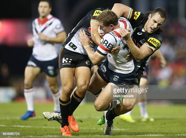 Mitchell Aubusson of the Roosters is tackled during the round three NRL match between the Penrith Panthers and the Sydney Roosters at Pepper Stadium...