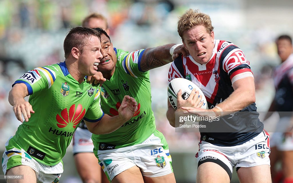 Mitchell Aubusson of the Roosters is tackled during the round two NRL match between the Canberra Raiders and the Sydney Roosters at GIO Stadium on March 12, 2016 in Canberra, Australia.